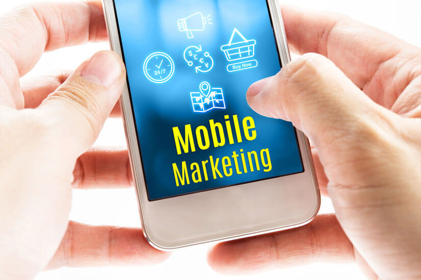 11-Close-up-two-hands-holding-smart-phone-with-Mobile-Marketing