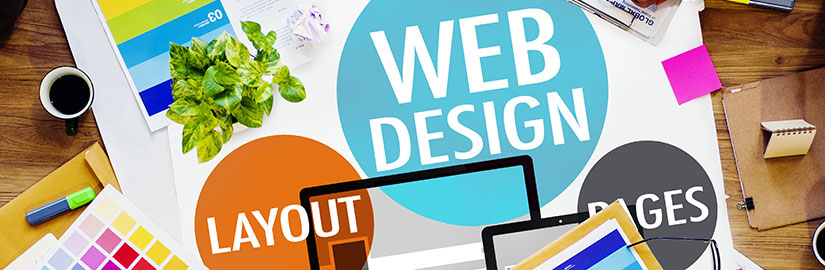 Web design image on a table of a designer working on creating a website