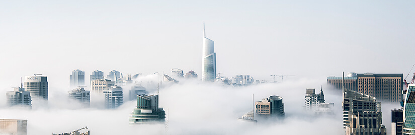 Sky scrapers rising above the clouds depicting outgrowing your competitors when using these e-commerce trends in 2018