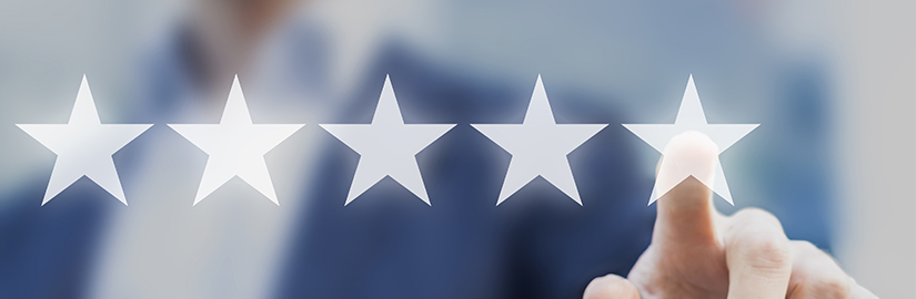 Person pointing at a five star rating