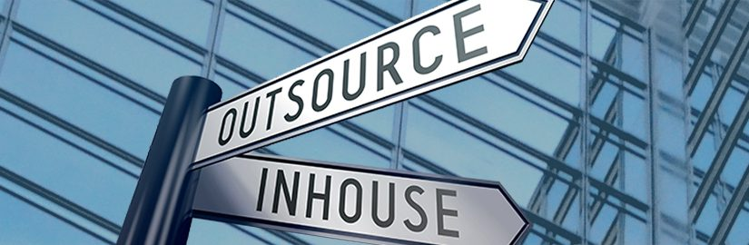 outsource and inshouse pointing in different directions infront of a building