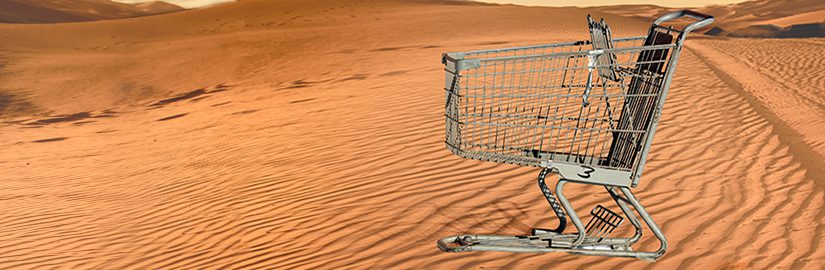 Abandoned shopping trolley standing in the desert, signifying an abandoned cart – the topic of this blog.
