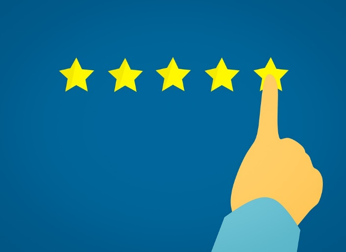 Image sugesting a five star rating. Image contains five yellow stars next to each other with a hand poiting to the most right star.